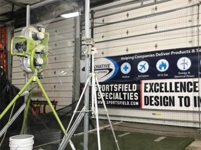 pitching machine and scaled down netting system set up in a testing warehouse at ITS in Troy NY